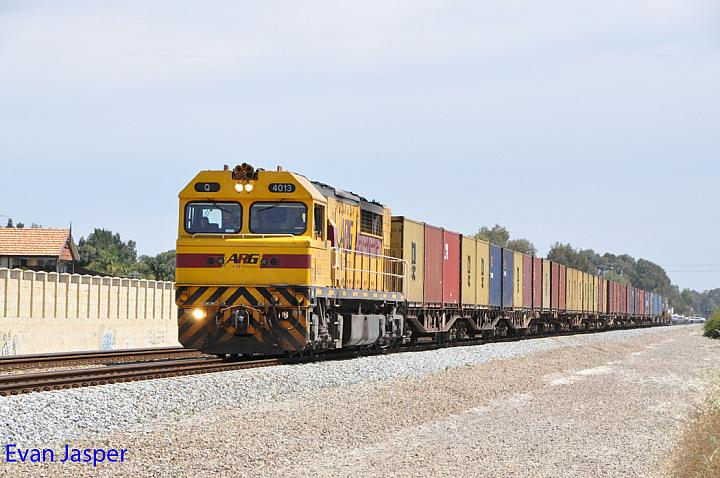 Q4013 on 4195 container train seen here heading though Thornlie for Forrestfield on the 29th October 2014
