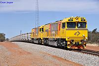 ACN4147 and ACN4144 on 7763 loaded iron ore train just west of Mullewa on the 1st December 2012