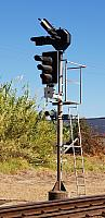 3 Aspect Globe Signal with a Globe Shunt Signal below and has 2 Route Indicators up top (Signal 18) This Type of signal is control by Train Control