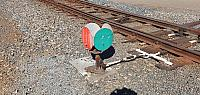This is a points indicator which is linked to the ridged points and lever, green set for the main, red set for the loop/siding.